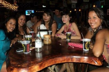 Women in a local bar doing what women do best in Costa Rica. Photo from Facebook