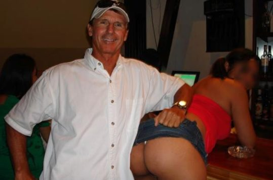 "David ""Cuba Dave"" Strecker posing with two sex workers. All photos courtesy of David Strecker, from VICE.com"